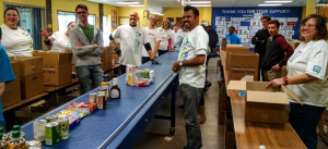 Johnson Controls Team ready to sort food!